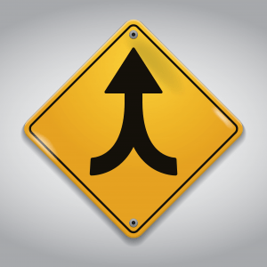 street sign for a vehicle merger