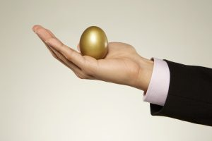 hand holding a golden egg