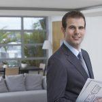 Businessman Holding Building Plans