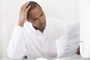 man studying a nonprofit grant proposal