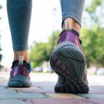 Footwear on female feet running on road outdoors