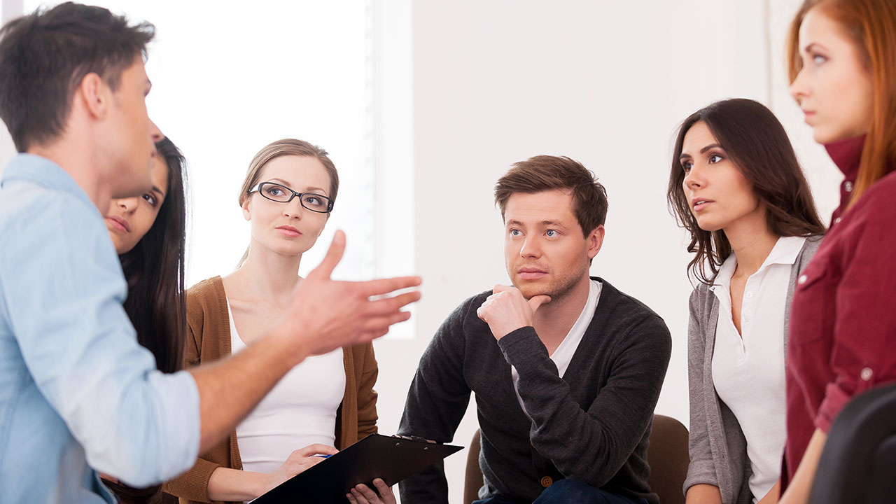 Group of people holding a discussion