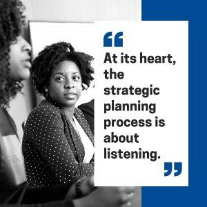 women listening at meeting