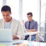 Male employee networking in office