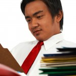 Office Manager Overworked And Stressed Viewing Many Reports